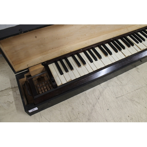 59 - Practice Keyboard A practice keyboard in a carrying case. AMENDMENT Is not a practice keyboard. Is a...