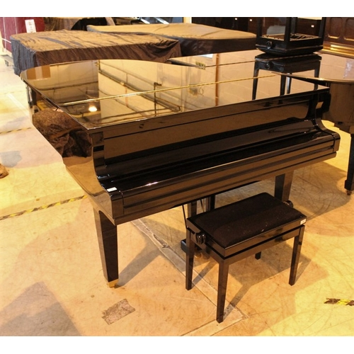 4 - Yamaha (c2009)  A 5ft 6in Model GC2 grand piano in a bright ebonised case on square tapered legs; to...