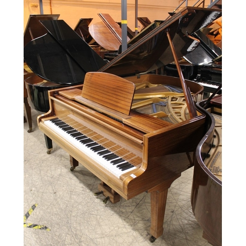 12 - Blüthner (c1968)  A  6ft 3in Aliquot strung grand piano in a bright mahogany case on square tapered ...