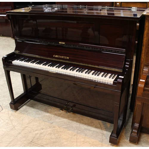 53 - Bechstein (c1920's)  A Model 9 upright piano in a bright mahogany case. This piano has been fully re...