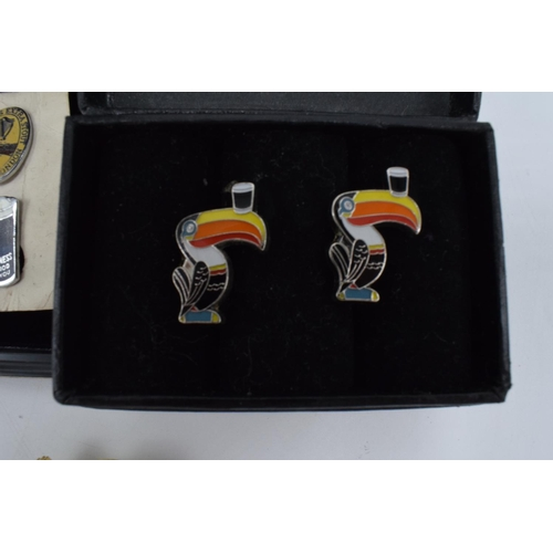 13 - Guinness Advertising items to include: 2 pairs of cufflinks and a badge...