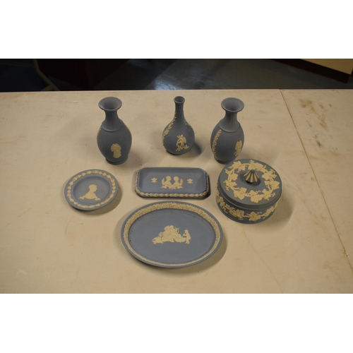 6 - A collection of Wedgwood Blue Jasperware to includes vases, trinkets etc (7)...