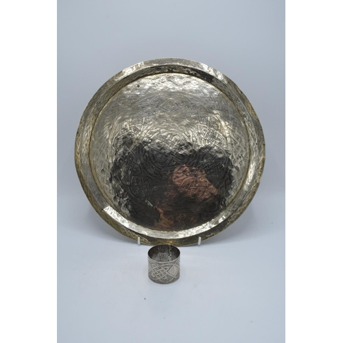 15 - Aikin Amade Kano Nigerian handcrafted white metal decorative charger together with matching napkin r...