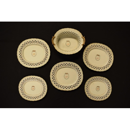 194 - Chinese export pierced porcelain painted with a family crest to consist of a desert basket with stan...