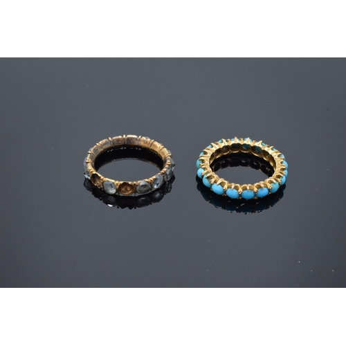 215 - Two full eternity style gem set rings set in yellow coloured metal: Both rings UK size K, gross weig...