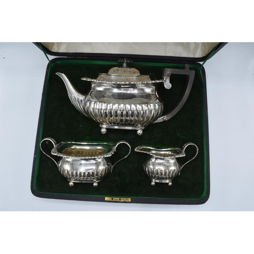 222 - Silver 3 piece tea set to include the teapot, milk and sugar: hallmarked for London 1905 (1120 grams...