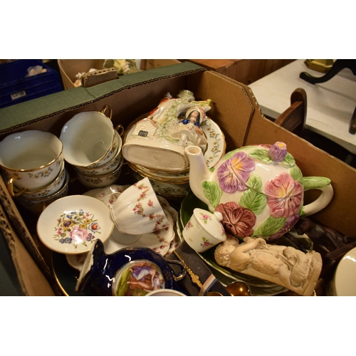 5G - A mixed collection of items to include a Staffordshire flatback, tea ware, vases etc  Condition is m...