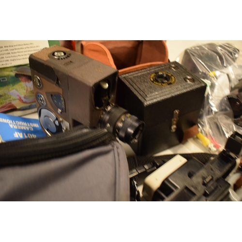 5K - A mixed collection of cameras and accessories to include Kodak, Canon, JVC etc  Condition is mixed. ...