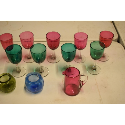 5U - A collection of various coloured 20th glass to include wine glasses of different sizes, bowls etc (s...
