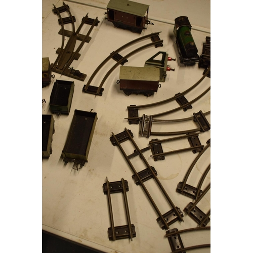 5V - A collection of Hornby (Meccano Ltd) model trains, carriages and track (well used)  All in bad and u...