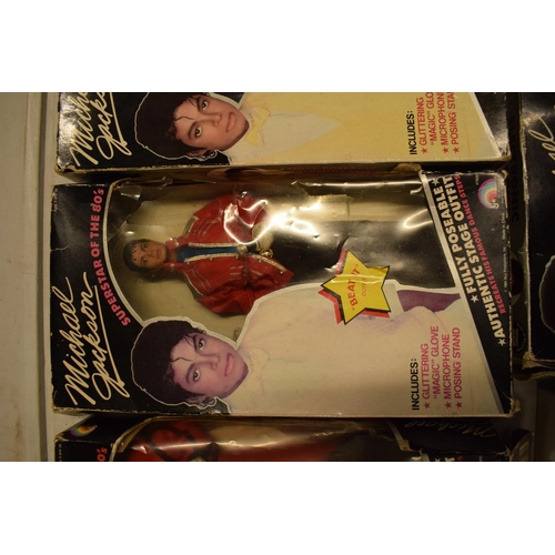 5W - A collection Michael Jackson figures and toys to include 'BAD' figure, electronic microphone and Sup...