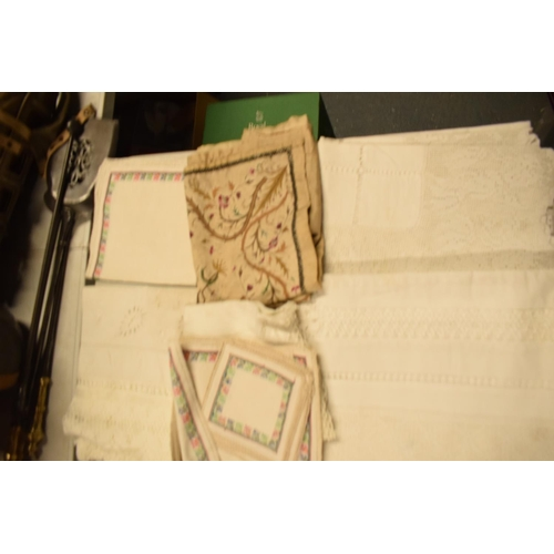 17 - A collection of 19th and 20th century linen and table cloths...