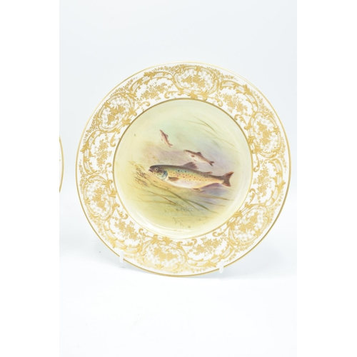 128 - Royal Doulton heavily gilded cabinet plates to include a Brown Trout and a Pike (2) In good conditio...