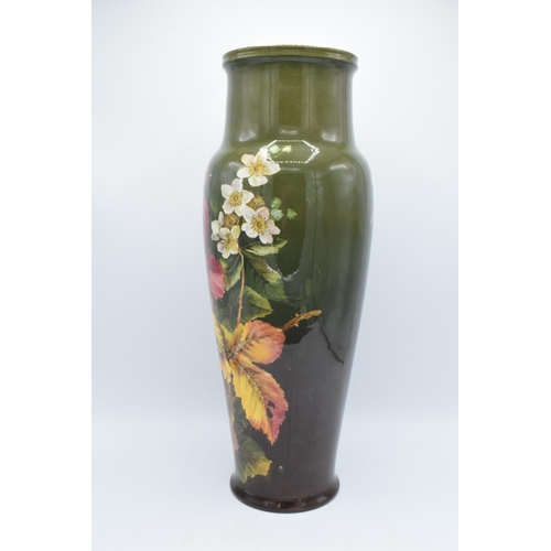 129 - Doulton Lambeth Faience vase with a floral design, initialled MW- Minnie Webb, 48cm tall. The item h...
