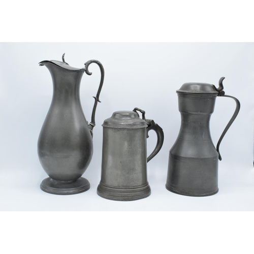 21 - Early 19th century pewter to include a flagon, a jug and a lidded tankard (3) As expected. Flagon ha...