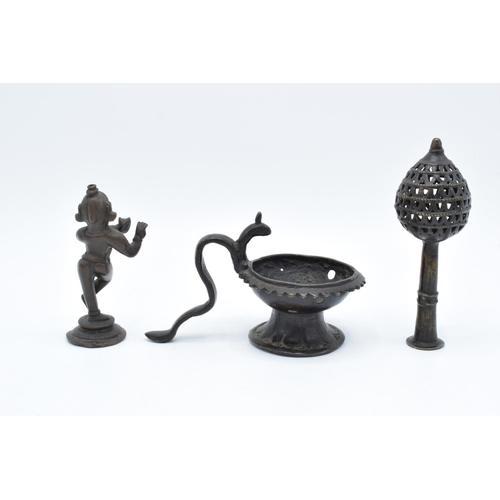 22 - A collection of antique Oriental/ Asian bronze items to include a lamp, a figure of a goddess and an...