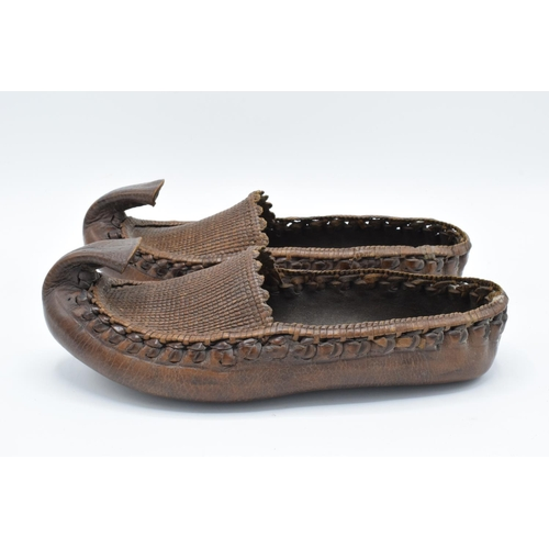 24 - Antique leather and wicker work pair of shoes/slippers, potentially Turkish. In good condition with ...