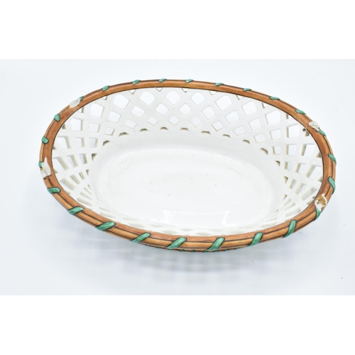 25 - Ed Honore á Paris pierced oval dessert baskets (a/f) Both are lacking their handles. One has hairlin...