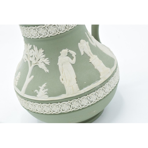 15 - Wedgwood Jasperware sage green footed bowl together with a water jug and a black vase (3). In good c...
