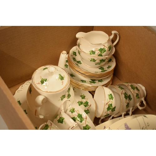 17 - A mixed collection of tea ware to include Colclough in a green lily design to include a teapot, milk...
