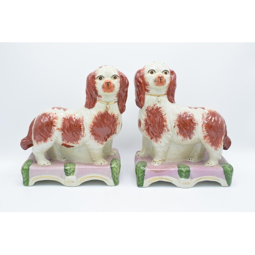3 - Pair of 20th century reproduction Staffordshire dogs on domed bases (2) In good condition with no ob...