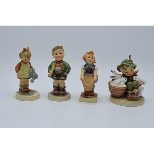 32 - A collection of Hummel and Goebel child figures (4). In good condition with no obvious damage or res...