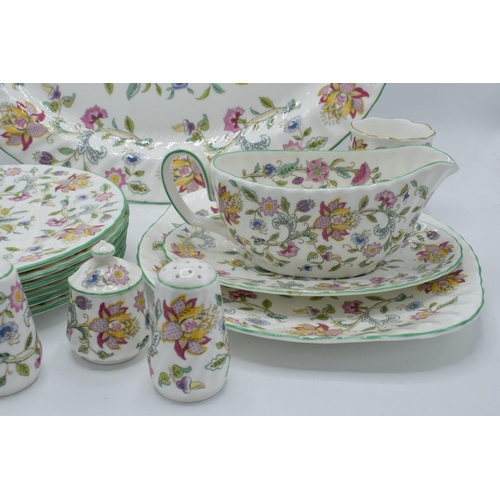 37 - A collection of Minton Haddon Hall items to include a large oval platter, cruets, gravy boat, 6 x 8