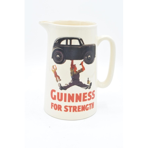 4 - Guinness pub advertising jug 'Guinness for Strength'. In good condition with no obvious damage or re...