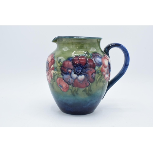 46 - Moorcroft 1950s jug in the Anemone pattern. In good condition with no obvious damage or restoration....