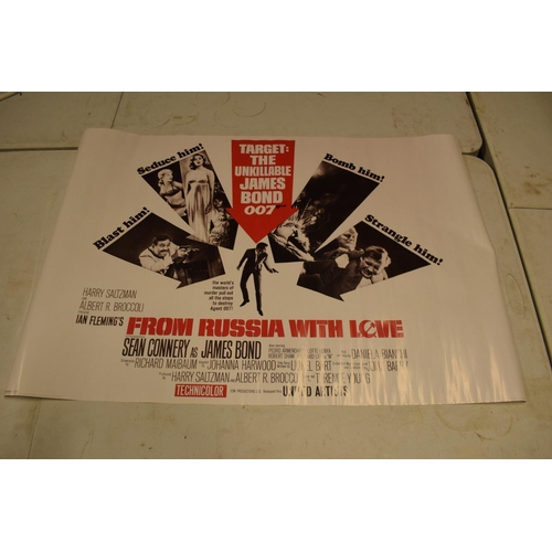 5Q - A large collection of reprinted movie posters for a wide range of films (approx 40)  Some are brand ...
