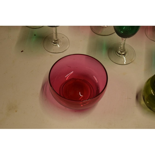 5R - A collection of various coloured 20th glass to include wine glasses of different sizes, bowls etc (s...