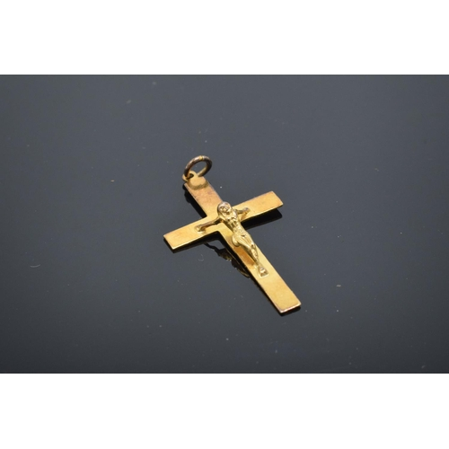 217 - 9ct gold crucifix pendant with full hallmarks, 0.9 grams