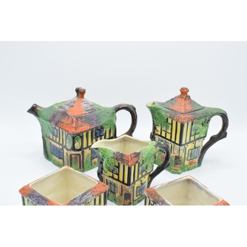 1 - A part tea set in the Ye Olde Inne design, believed to be Royal Winton/ Grimwades, to include a tea ...