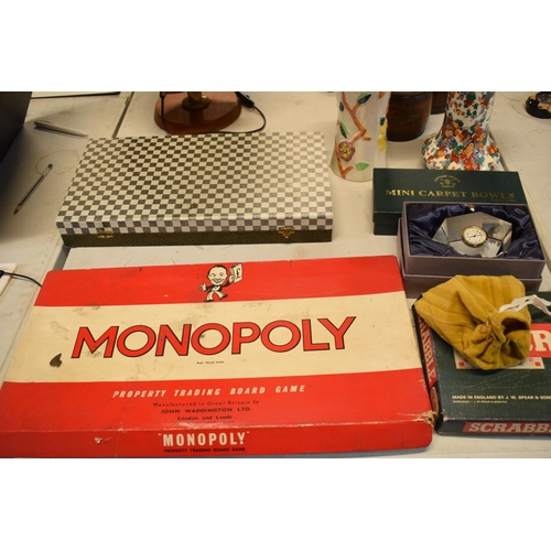 11 - A mixed collection of items to include board games such as Monopoly and Scrabble (may be incomplete)...