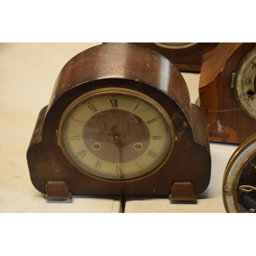 12 - A collection of wooden cased mantle clocks, all spares and repairs. No postage.