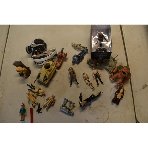 16 - A mixed collection of toys and figures to include Star Wars, Doctor Who etc.