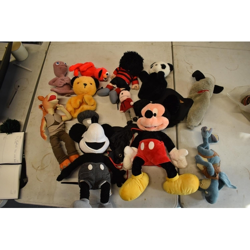 18 - A collection of cuddly toys to include Dennis the Menace, Star Wars, Mickey Mouse etc.