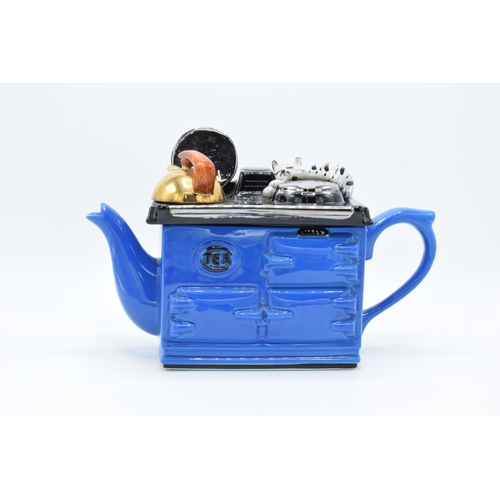 23 - Swineside Ceramics novelty teapot in the style of an aga with a cat. In good condition without any o...