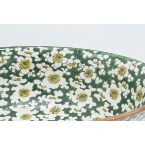 24 - A large late 19th/ early 20th century Japanese thick porcelain bowl with a floral green design. Show...