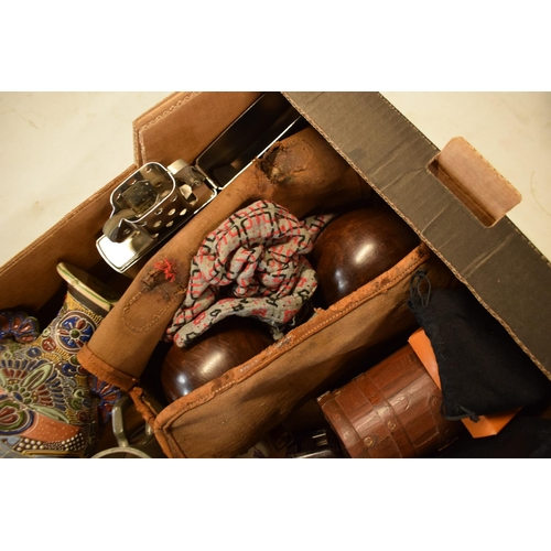 29 - A mixed collection of items to include a pair of lawn bowls, brass candlesticks, tankards, 20th cent...