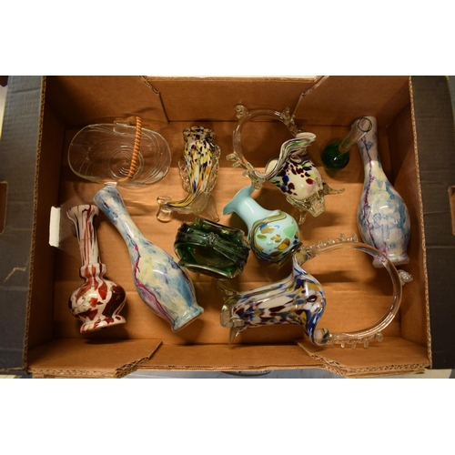 30 - A mixed collection of glassware to include Murano-style items such as fish, baskets, vases etc. No p...