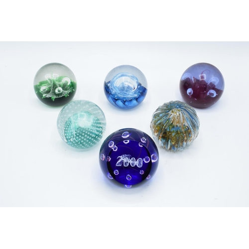 31 - A collection of Caithness paperweights to include Moonflower, Cauldron, Moonflower, Millennium, Quic...
