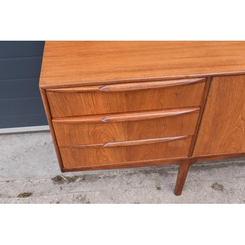 310 - A.H. Mcintosh Of Kirkcaldy retro 1960s teak sideboard raised on tapered legs. Approx 208 x 46 x 76cm...