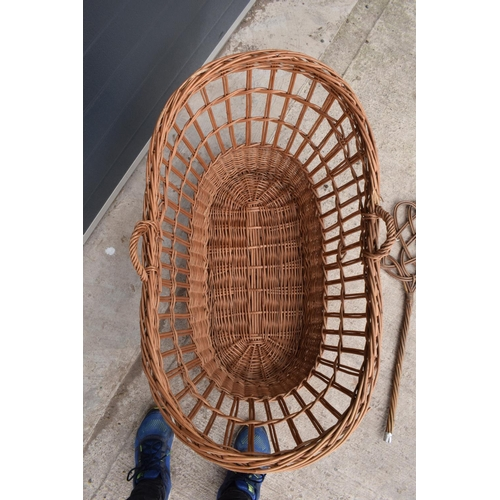 311 - A large wicket basket together with a carpet basher (2).