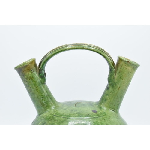34 - A 19th century decorative earthenware vase with double spout and bridge style handle.  In good condi...