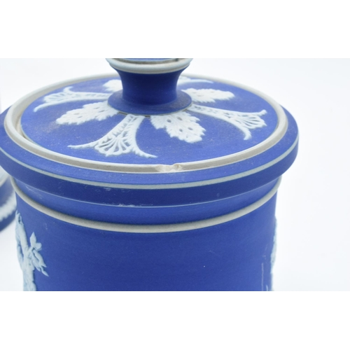 42 - A collection of Adams of Tunstall blue jasperware to include 2 bulbous vases with threaded rims and ...