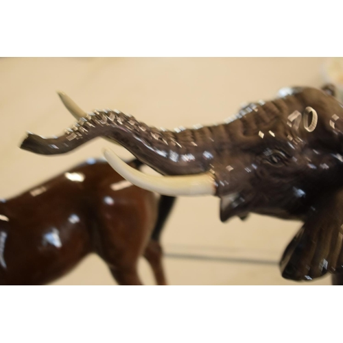 6 - A collection of mainly Beswick animals to include elephants, a bull, birds and horses etc (all as fo...