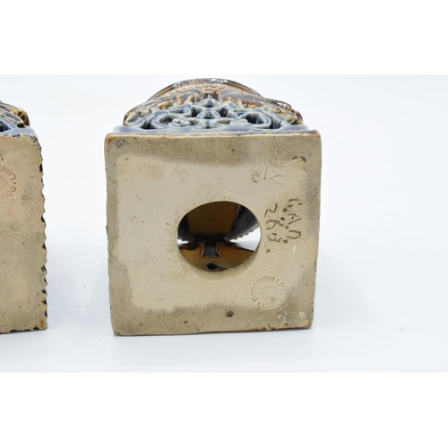 95 - A near pair of Doulton Lambeth table salts with a bird design, circa 1876 with marks to base. In goo...