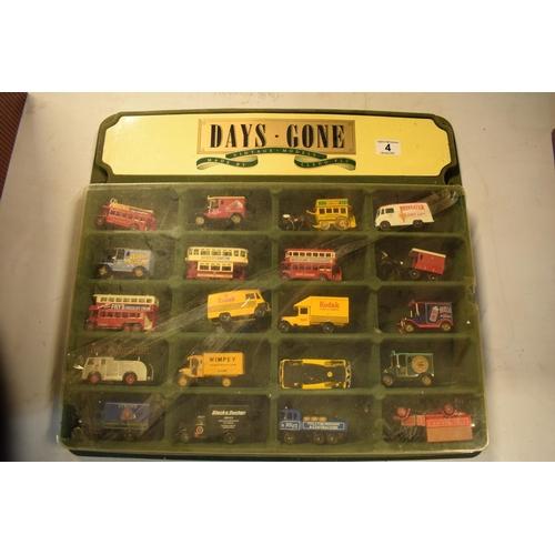10r - Days Gone /Lledo Vintage Models display unit together with 20 vehicles (21). Felt on display has fad...