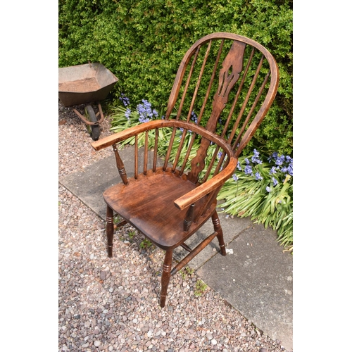 349 - A 19th century Windsor farmhouse armchair. In good condition with age related wear and tear to inclu...